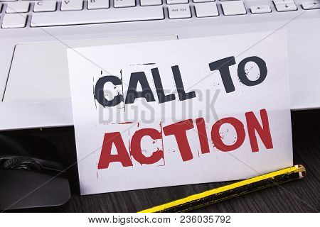 Text sign showing Call To Action. Conceptual photo most important part of online digital marketing campaign written White Sticky Note Paper placed wooden table Pencil Laoptop Mouse. stock photo