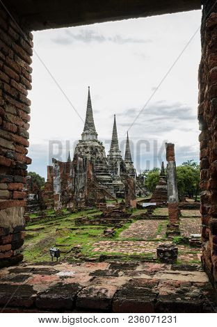 Beautiful view of three white pagoda in red window brick frame. Wat Phra Si Sanphet, the ruins and ancient of the former royal temple in Ayutthaya Historic Park, Thailand stock photo