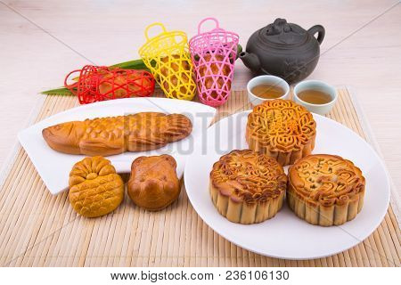 Mooncake for Chinese mid-autumn festival celebration, wih ingredients and tea on table top stock photo