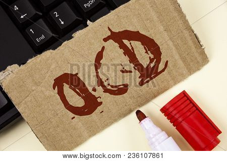Text sign showing Ocd. Conceptual photo Obsessive Compulsive Disorder Psychological Illness Medical Condition written Tear Cardboard Piece plain background Keyboard and Marker next to it. stock photo
