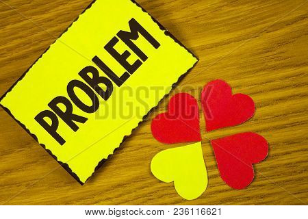 Conceptual hand writing showing Problem. Business photo text Trouble that need to be solved Difficult Situation Complication written Sticky note paper wooden background Paper Love Hearts stock photo