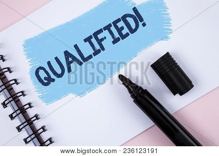 Text sign showing Qualified Motivational Call. Conceptual photo Certified to perform a job Competent Experienced written Painted Notepad plain Pink background Marker next to it. stock photo