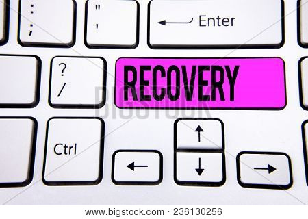 Conceptual hand writing showing Recovery. Business photo text Return to normal state of health Regain possession or control written Key Button White Keyboard with copy space. Top view. stock photo