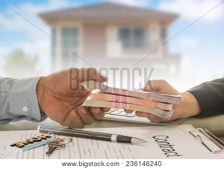 Mortgage loan real estate property concept. Banker give loan money to debtor. stock photo