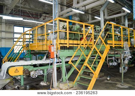 Line for the manufacture of brown colored synthetic acrylic fiber at a chemical plant stock photo