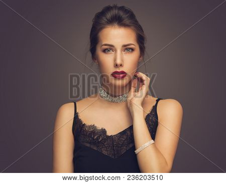 Beautiful model girl with elegant hairstyle . Woman with red lips and nails . Cosmetics, beauty and manicure on nails stock photo
