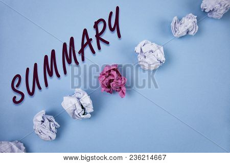 Handwriting text writing Summary. Concept meaning Brief Statement Abstract Synopsis Concise Abbreviated version written Plain Blue background Crumpled Paper Balls next to it. stock photo