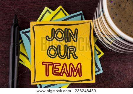 Writing note showing  Join Our Team. Business photo showcasing Get over unemployment joining better career workforce written Sticky Note paper Wooden background Coffee Cup and Marker stock photo