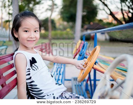 Happy kid, asian baby child playing on playground, car stock photo