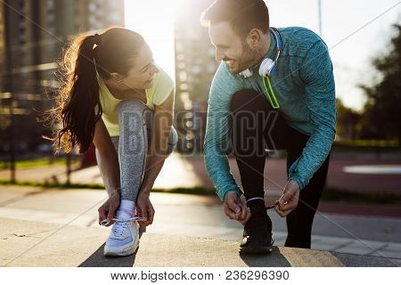 Happy friends fitness training together outdoors living active healthy lifestyle stock photo