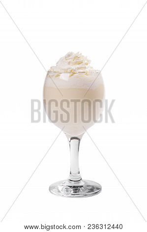 Pina colada, creamy cocktail in a high glass with crushed ice frappe with a taste of caramel, coffee, whipped cream. Side view. Isolated white background. Drink for the menu restaurant, bar, cafe stock photo