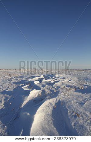 Winter landscape with Sastrugi, wind carved ridges in the snow, near Arviat Nunavut Canada stock photo