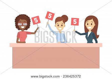 Judgeson panel with sign boards to show the score. stock photo