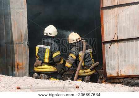 fireman extinguishes fire.The concept of saving people in a fire stock photo