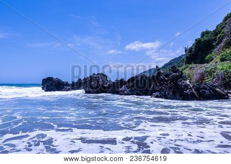 Wild tropical beach next to Caracas (Vargas, Venezuela). stock photo