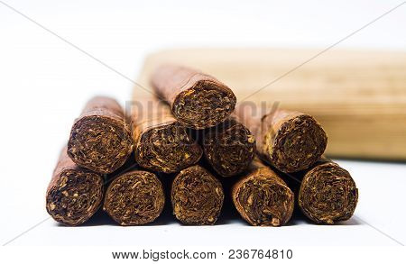 Cuban cigars on a pile isolated on white stock photo