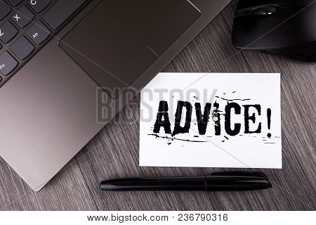 Writing note showing  Advice Motivational Call. Business photo showcasing Learn to be good at advicing people, businesses written Sticky Note Paper the wooden background Laptop Mouse Pen stock photo