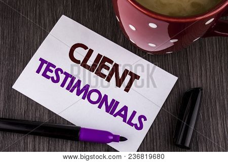 Word writing text Client Testimonials. Business concept for Customer Personal Experiences Reviews Opinions Feedback written White Sticky Note Paper the wooden background Cup Marker stock photo