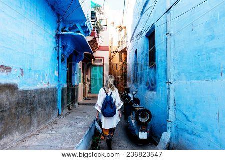 Western woman exploring the blue city, Jodhpur India stock photo