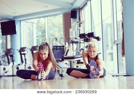 woman exercise and  working out with fitness personal trainer in gym
