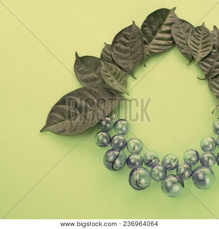 Grapes Artificial Glass on green background. Flat lay top view stock photo