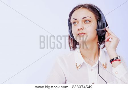 Office work. Portrait of happy smiling cheerful support phone operator in headset on white background. stock photo