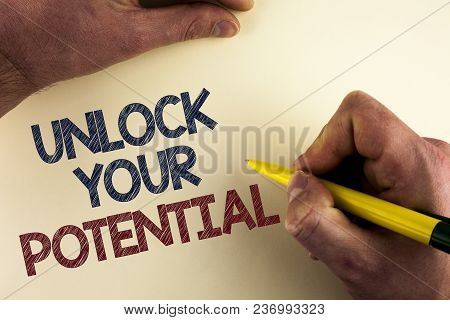 Word writing text Unlock Your Potential. Business concept for Reveal talent Develop abilities Show personal skills written by man plain background holding Pen in Hand. stock photo