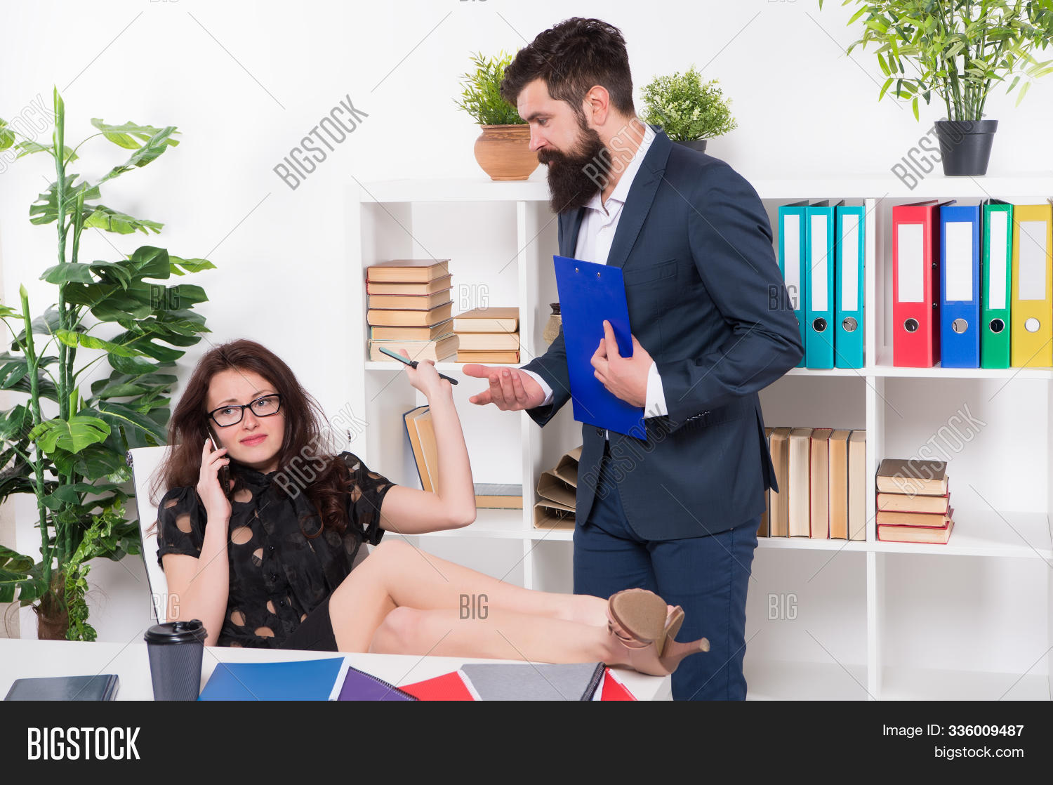 Im busy. Busy secretary talk on phone. Working couple in office. Business partners. Busy working day. Dont be busy be productive.