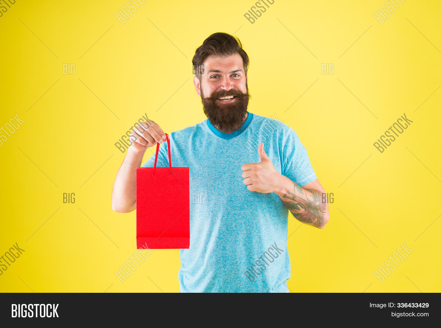 pleasant prices here. cyber monday concept. little pleasantness. bearded man go shopping. store for men. mature male beard with purchase. happy hipster hold red paperbag. best offer. Man with package.