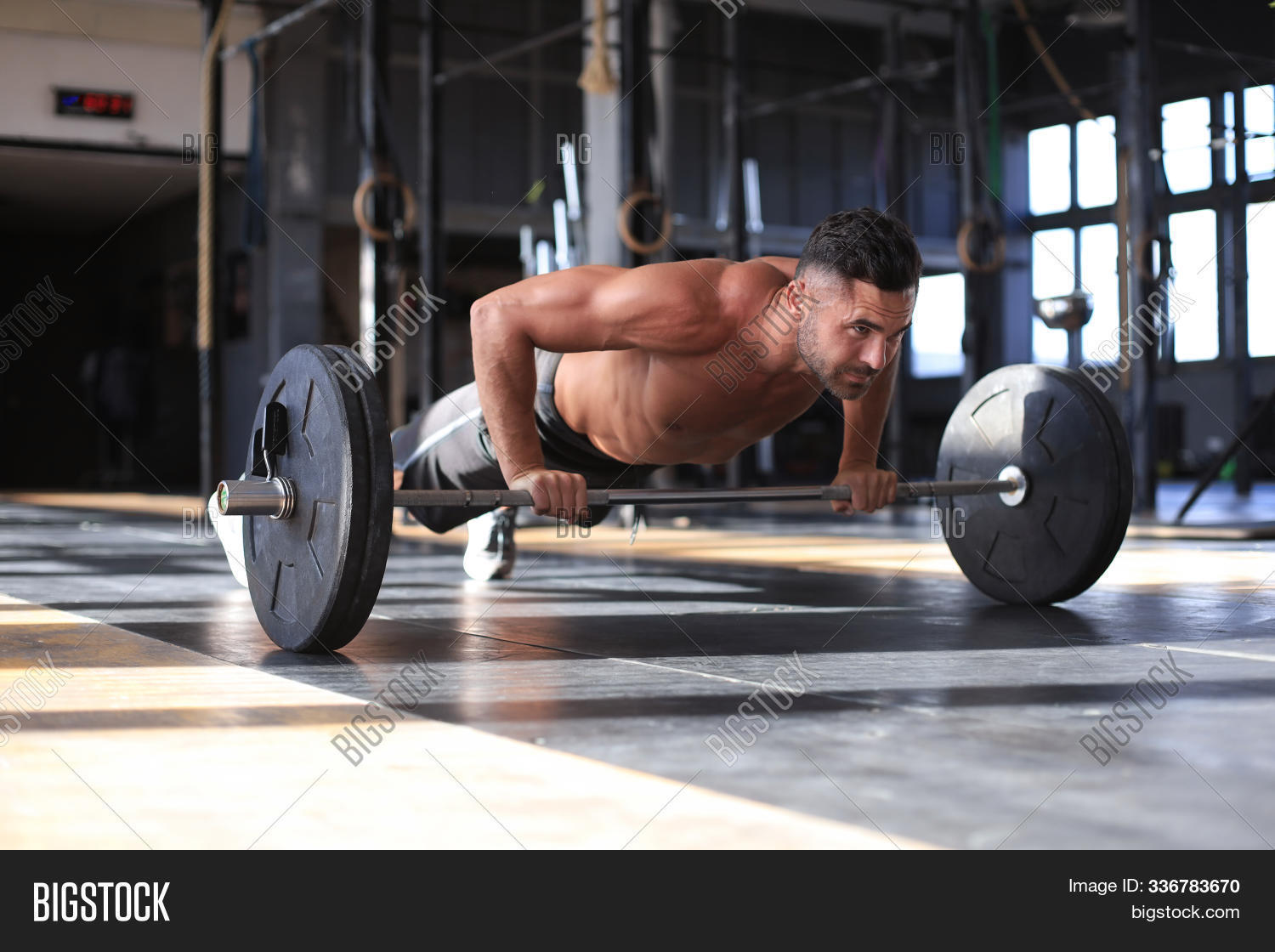 active,adult,athlete,athletic,attractive,bars,body,bodybuilding,building,club,dumbbell,effort,equipment,exercise,fit,fitness,floor,forearm,girl,gym,hand,heavy,horizontal,indoor,lift,male,man,mid,muscular,parallel,parallettes,perfect,physique,plank,portrait,power,pretty,push,push-up,pushup,sport,strength,trainer,training,up,weight,workout,young