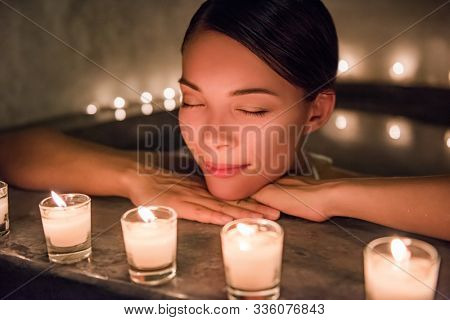Beautiful young woman relaxing in jacuzzi hot tub at spa. Attractive female tourist is enjoying in water. Smiling woman with eyes closed is pampering herself during vacation. stock photo