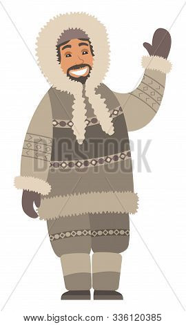 Eskimo man stand alone and wave hand. Indigenous north guy with smile on face and in warm clothes like coat and gloves, boots and hood. Arctic person isolated on white. Vector illustration in flat stock photo