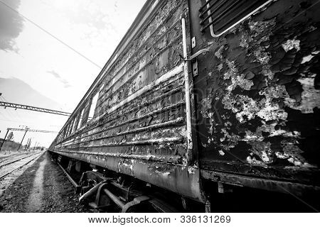 old rusty weathered peeled paint of an old wagon. Blue abandoned railway carriage. Old railwaystation. stock photo