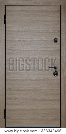 beautiful modern wooden entrance door to the apartment stock photo