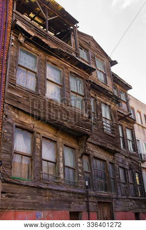 Traditional historic wooden buildings stand semi-derelict in the Zeyrek district of Fatih, Istanbul stock photo