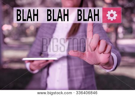 Writing note showing Blah Blah Blah. Business photo showcasing Talking too much false information gossips nonsense speaking Outdoor scene with business woman holds lap top with touch screen. stock photo