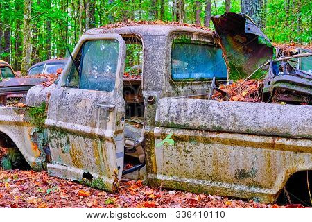 Old Abandoned Truck Pitted with Rust and Covered with Moss and Mildew stock photo