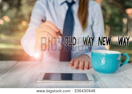 Word writing text Old Way New Way. Business concept for The different way to fulfill the desired purposes Business woman sitting by the table with cup of coffee and mobile phone. stock photo