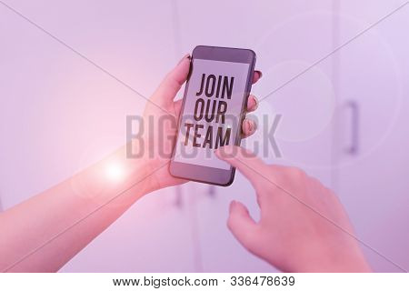Word writing text Join Our Team. Business concept for Allied Associate Work with us New Employee Hired Enlist woman using smartphone office supplies technological devices inside home. stock photo