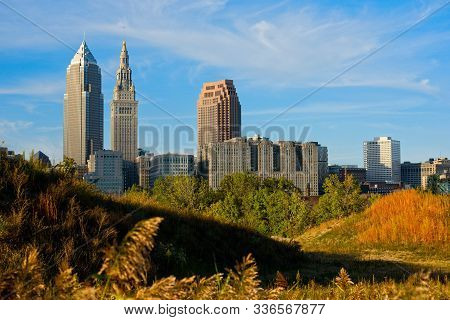 The three main skyscrapers of the Cleveland Ohio skyline as seen from a trail in the Flats area across the river stock photo