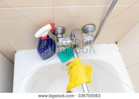 Cleaning products, agents gloves and sponge for washing dirty faucet with limescale, calcified water tap with lime scale on washbowl in bathroom stock photo