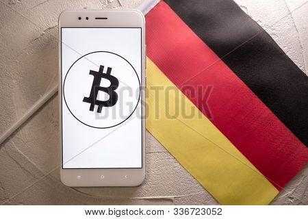 Cryptocurrency And Government Regulation, Concept. Modern Economy, Smartphone With Bitcoin Sign On T