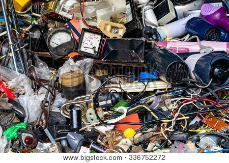 Old defective electrical appliances, parts, miscellaneous wires for sale in the market stock photo