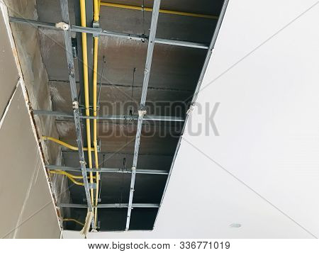 Ceiling panels damaged hole in the roof of house. Ceiling is broken, gypsum board is damaged. Dropped out of ceiling house is damaged on ceiling. stock photo
