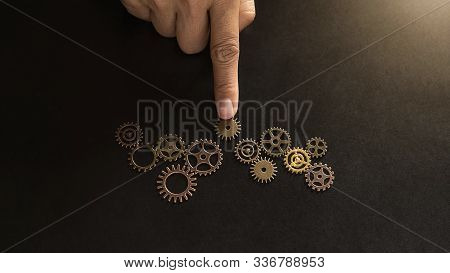 Business Solutions for Success and Strategy. Businessman hands connect the gears with a puzzle. Fulfill and fix the problem of incomplete teamwork. stock photo