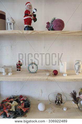 Miscellaneous on the wall shelf. Shelves on the white wall. Decorative elements on the shelf. stock photo