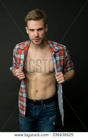 Hes sexy and he knows it. Sexy man in unbuttoned shirt. Handsome guy with sexy bare torso. wellness and bodycare. Attractive and sexy. stock photo