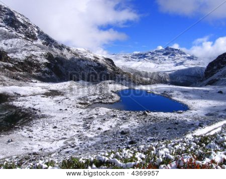 A samll lake in high altitudes of Tawang (15000') a remote place in extreme tip of Arunachal pradesh India. The place is full of big and small beautiful lakes. The land scape of the region changes every 5 minutes due to fast changing weather. stock photo