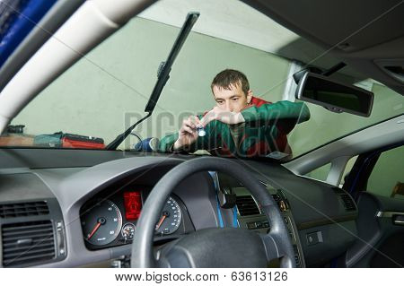 Automobile glazier repair windscreen or windshield of a car in auto service station garage stock photo