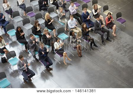 Overhead View Of Audience Applauding Speaker At Conference stock photo
